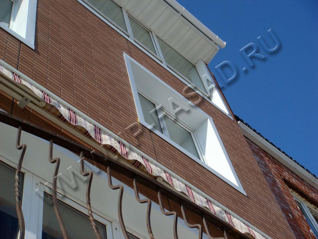 Фасад из панелей под кирпич