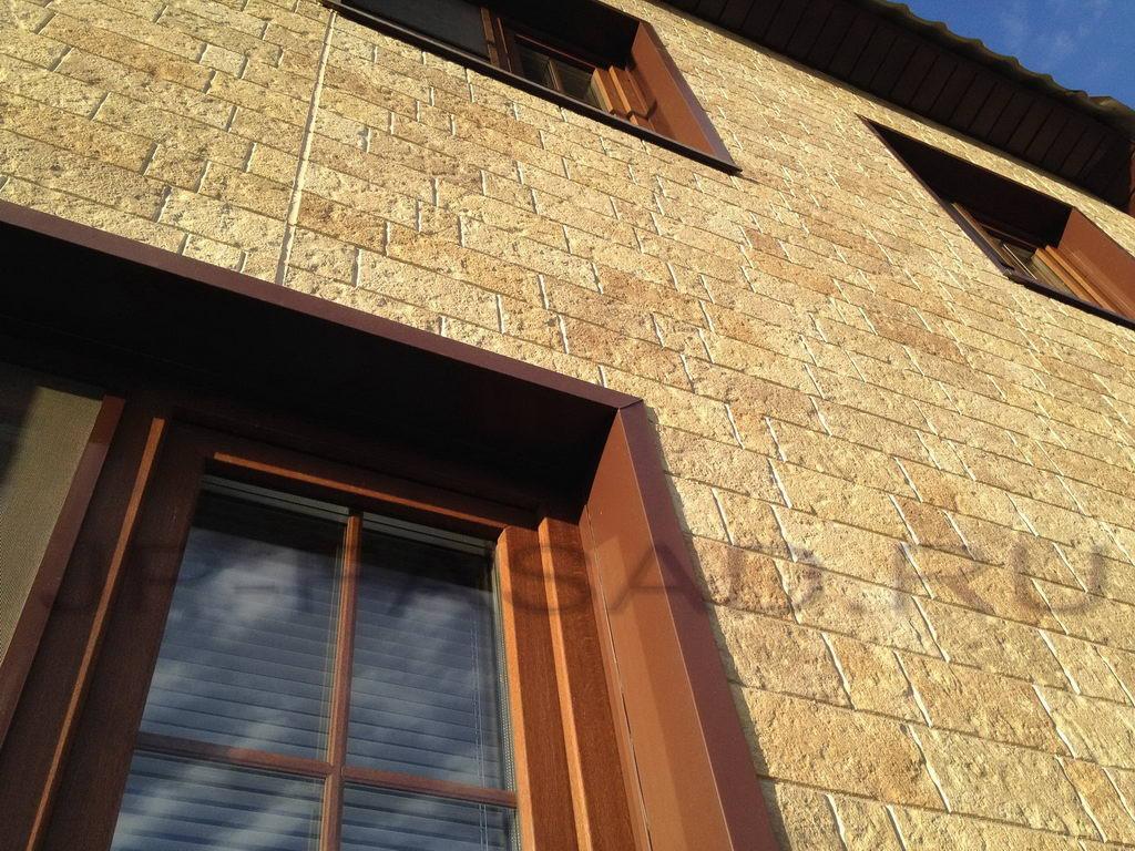 Фасад из панелей под камень выглядит очень натурально